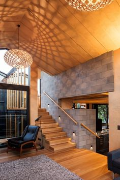 Strachan Group Architects together with Rachael Rush have completed the Boatsheds, a family home in Auckland, New Zealand that features David Trubridge KINAS #lighting