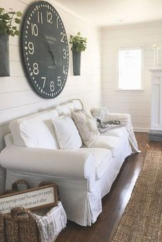 Love this farmhouse living room decor idea - that BIG rustic wall clock is amazing!