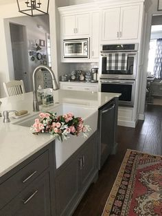 99 Farmhouse Kitchen Ideas On A Budget 2017 (23) - JUST GORGEOUS!! - LOVE THE DARK FLOORS & CABINETS WITH THE WHITE COUNTER TOPS!! LOOKS STUNNING, AS DOES THE AWESOME SINK!!