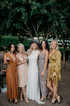 boho bride and mismatched bridesmaids in earthy tone dresses