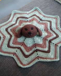 Crochet lovey for my nephew, or a cuddle cloth as we call it in norwegian. Eight point star blanket and a dog in the middle. Here is how to make the dogs head:  https://www.youtube.com/watch?v=U7txVkESvQI                 MN