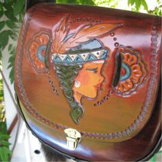 Tiger-Lilly.......... Hand-Tooled Leather Purse Custom Made-to-Order. $279.00, via Etsy.