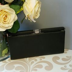 """Forever 21  simple black clutch #102815 black faux leather silver snap closure  1 inside zipper pocket  2 inside open pockets  5"""" tall  9.5"""" long 1.25"""" wide  3.5"""" opening         Great condition!      **Ask to Bundle with any other listing(s) for discounts & reduced shipping!** Forever 21 Bags Clutches & Wristlets"""