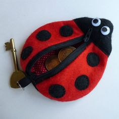 Ladybug Key Chain Coin Purse (PDF Sewing Pattern Download) by TheCraftPixie, £2.99 --- So cute! A fully lined purse that can hang from a bag or tuck inside. Attach your keys to the key ring and fill his tummy with your loose change.