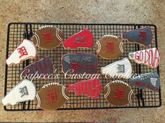 Custom Dover/Phila week football and megaphone cookies. Decorated with royal icing.