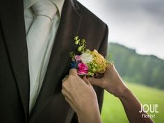 Small summer wedding in nature, flower for the groom