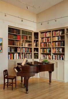 built in bookshelves, piano  (track lighting)