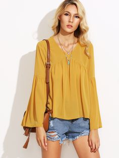 Shop Yellow V Neck Pleated Dip Hem Blouse online. SheIn offers Yellow V Neck Pleated Dip Hem Blouse & more to fit your fashionable needs.