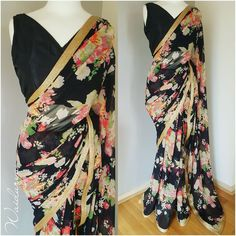 Beautiful black color silk saree with floral print.Black color designer blouse with sleeveless.