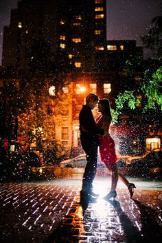 """I love how the flash is making a rainstorm evoke a quiet snowy moment. We got a massive storm in NYC in the middle of an engagement shoot. I knew it was coming, so I said to the couple: """"We can either stay nice and dry and shoot in Grand Central … or we can play in the rain and try for something extraordinary.""""  I'm very happy they chose to play in the rain with me. My pocketwizard contacts started shorting out about 30 seconds after this photo (but were fine after a quick toweling-off)."""