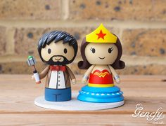 Dr. Who groom (11th doctor) and Wonder Woman bride wedding cake topper by Genefy Playground.  https://www.facebook.com/genefyplayground