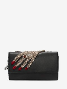 Shop Women's Jeweled Hand Insignia Chain Pouch from the official online store of iconic fashion designer Alexander McQueen.