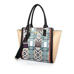Purple geometric print winged tote handbag