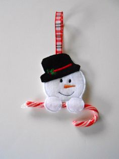 This is a felt embroidered Snowman candy cane holder ornament that is the last of the group I am making for this year's Christmas fare. In my shop now!