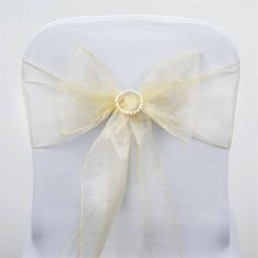 Champagne Organza Chair Sash | eFavorMart /  Beautiful and charming crystal organza chair sashes are a real treat to eyes and big attention grabbers. Add that sophisticated touch of chic elegance into your event's décor with our splendid sheer organza chair sashes. Made from premium quality nylon, these chair sashes will impart an impeccable sheen and glossy luster to your plain reception or wedding chairs and chair covers, creating that super WOW factor you so eagerly want to attain. Wrap…