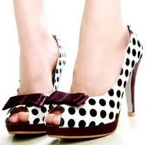 Bows, polka dots, black and white. Too much fun for one pair of shoes!