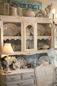I love this white hutch with the blue inside.