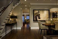 Contemporary Dining Room with Pendant light, Built-in bookshelf, Hardwood floors, Crown molding
