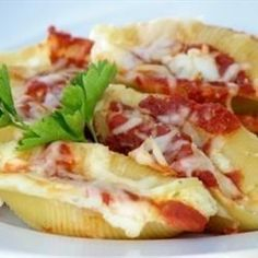 Jumbo pasta shells stuffed with ricotta, mozzarella and Parmesan, smothered in a mushroom tomato sauce and baked.