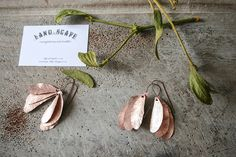 "Copper mistletoe leaf earrings from the Land{e}scape series, ""Under the Mistletoe""."