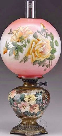 """lighting, America, Victorian decorated Gone with the Wind parlor lamp, The pink-to-cream globe shade paint-decorated with roses, fitted to the """"Wrght Butlar Duplex"""" burner and reservoir. fitted to a painted pottery base modeled with floral sprays, not dissimilar to the early work of Mary Louise McLaughlin and Maria Longworth Nichols storer. Raised on a cast-brass circular base. Circa 1851-1900"""