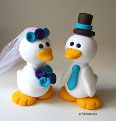 Lots of cute wedding cake toppers  from @fliepsiebieps on Etsy.