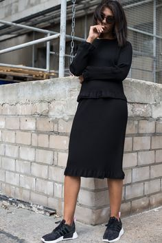 storm wears black skirt from cos with black matching top and adidas NMD sunnies
