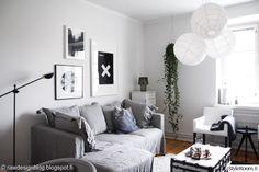 olohuone,sohva,sohvanpäällinen,taulut,muratti