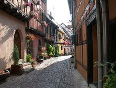 France. Eguisheim (German: Egisheim) is a commune in the Haut-Rhin department in Alsace in north-eastern France. Eguisheim produces Alsace wine of high quality. In May of 2013 it was voted the «Village préféré des Français» (Favorite French Village), an annual distinction that passes from town to town throughout France.