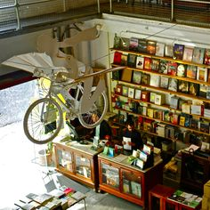 30 Most Beautiful Bookshops Around The World  7. Ler Devagar, Lisbon, Portugal This state of the art modern bookstore occupies multiple stories of a former factory in Lisbon, a building built in 1864 to manufacture thread and fabric. Readers can delve in Portuguese and international paperbacks on various subjects while a bicycle with wings overlooks them.