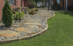 Gorgeous natural stone walkway accented with natural stone edging and gravel! Love this look!