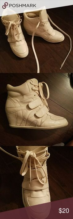 Cream colored wedge sneakers Wedge sneakers with two straps on front and shoelaces. Perfect for pairing with jeans and a tee. I love these shoes I just can't really pull them off. They don't have a size on them but I usually wear 9 or 9.5! Shoes Sneakers