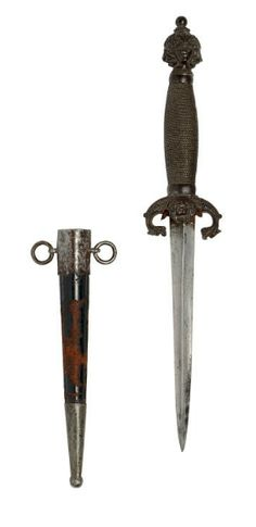 A DECORATIVE GERMAN DAGGER IN 16TH CENTURY STYLE   19TH CENTURY   With tapering blade of hollow triangular section, cast iron hilt comprising guard with lion-mask quillon-block and downturned serpentine quillons, and pommel decorated in relief with lion and human masks with button finial, and wire-bound grip, in original black leather covered iron mounted sheath with two suspension rings  5¾in (14.6cm) blade