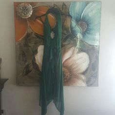 Emerald Green Prom Dress Asymmetrical. Fully lined with the ruffle detail going down the middle. chiffon cotton blend material. Some padding in the bust. Halter top.  jeweled brooch like detailing.  Will fit 5/7 Dresses Prom