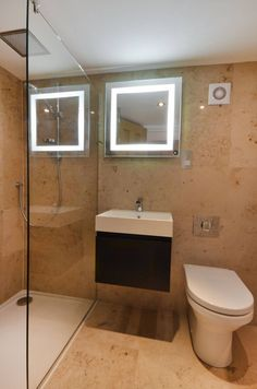 En Suite Shower Room - A walk in shower, nicely tiled walls and an amazing mirror make this en suite feel spacious and refreshing - simply gorgeous interior design