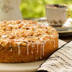 A recipe for Apricot Buttermilk Coffee Cake made with dried apricots, apricot jam, and buttermilk. It it topped with chopped walnuts and glazed.