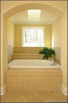 Barrel Vault alcove tub in the master suite bathroom.