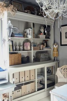 Drug store cabinet used for storage, love this look!