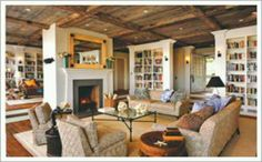 Twin bookcases & freestanding fireplace as a room divider.