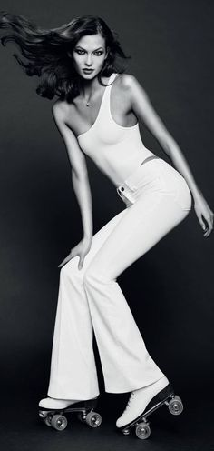Karlie Kloss in a 70's Charlie's Angels inspired shot.