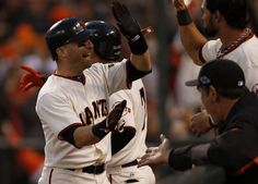 Giants' second baseman Marco Scutaro gets a high five from Angel Pagan after scoring in the 3rd inning during game 7 of the NLCS at AT Park on Monday, Oct. 22, 2012 in San Francisco, Calif. Photo: Michael Macor, The Chronicle / SF
