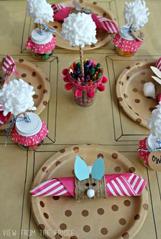 An adorable Easter Kids Table Setting Idea! DIY napkin rings, Baby Food Jar favors, and a draw on table cloth!! Perfect! Via View From The Fridge