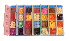 Toddler activity for the airplane: put snacks in each compartment of a pill organizer.
