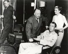 Alfred Hitchcock, Jimmy Stewart, and Grace Kelly backstage during filming of Rear Window (1954)