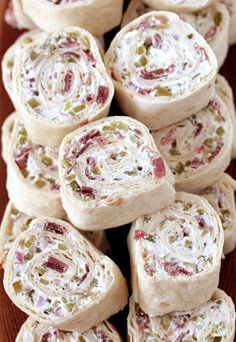 Dill Pickle Tortilla Roll Ups these party appetizers are filled with cream cheese sour cream light mayo dill pickles dry beef onion ground black pepper and garlic powder make a perfect choice for Game Day or any other party or holiday. Pickle Roll Ups, Pickle Wraps, Dill Pickle Dip, Tortilla Pinwheels, Roll Ups Tortilla, Tortilla Roll Ups Appetizers, Ham Pinwheels, Chicken Pinwheels, Cream Cheese Pinwheels