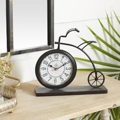 "Grayson Lane Vintage Style Brown Metal Penny-Farthing Clock 12"" x 13"" x 2"" in the Clocks department at Lowes.com Bicycle Clock, Penny Farthing, Tabletop Clocks, Wedding Giveaways, Metal Clock, Metal Desks, Desk Clock, Vintage Fashion"