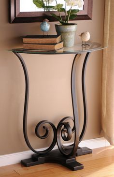 Sophisticated and stylish, this half round console table features metal and glass construction. #kirklands #eclecticelegance #accenttable