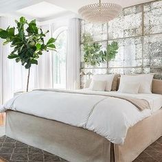 Antiqued Mirrored Headboard Panels with Slipcovered Bed