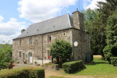 Country House for sale in Brittany, Côtes-d'Armor (22), Saint-Nicolas-du-Pélem | French-Property.com Pellet Burner, Stone Archway, Saint Nicolas, Heated Towel Rail, French Property, Pine Floors, Double Glazed Window, France, Next Door