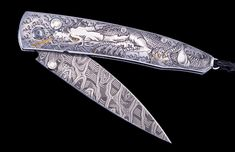 The Lancet 'Emperor's Dragon' by William Henry is a 5-piece edition featuring a mesmerizing hand-engraved handle with 24K gold inlays by Andrew Biggs; The blade is hand-forged 'Hornets Nest' damascus by Mike Norris; the one-hand button lock and the thumb stud are set with diamonds.  Sleek, elegant, refined, and comfortable in the hand and to the eye, the Lancet defines the essential gentleman's folder in the modern world.